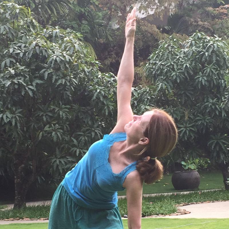 Yoga Instructor Cindy Bradley demonstrating Side Angle or Trikonasana Pose